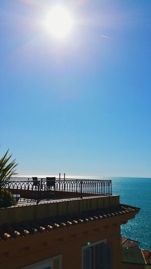 Scenic view of sea against clear sky on sunny day