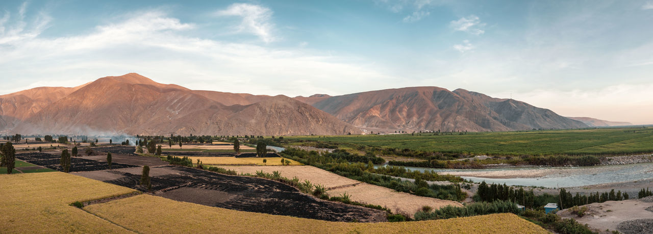 The way from Mejia to Huacachina. Outdoors Nature Travel Destinations Mountain Range Mountain Moody Explore Discover  Adventure Idyllic Tranquility Tranquil Scene Panorama Sky Day Oasis Desert Water Field Colorful Blue Sky No People Environment Agriculture Smoke