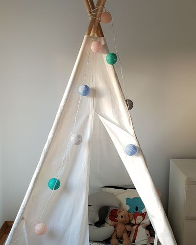 Happy place Tent Childhood Happiness Playing Cozy Place Cozy Place Cushion Lights Illumination Colorful Minimalism Children's Room Toys Chain Of Lights Tepee Cave Growing Up No People Light Chains Electricity  Beautiful Place At Home Interior Design Peaceful Prints Animal Themes Moon Mother And Son Pastel Colors Home Improvement