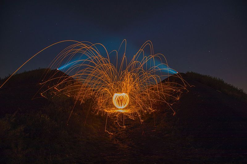 Steelwool EyeEm Best Shots First Eyeem Photo Photography Wallpaper EyeEmNewHere Steelwoolphotography Night Illuminated Motion Sky Glowing Long Exposure No People Nature Outdoors Orange Color Star - Space Arts Culture And Entertainment Blurred Motion Light - Natural Phenomenon Creativity Exploding Astronomy Space Beauty In Nature Celebration