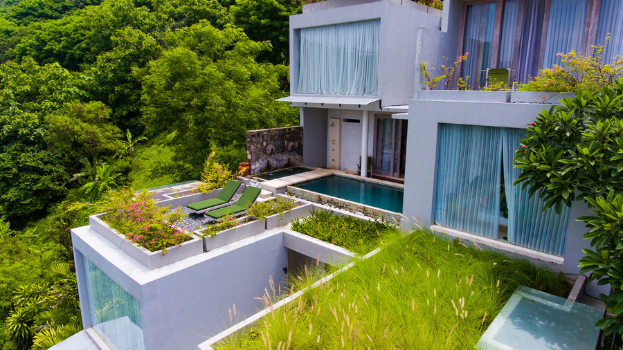Svarga resort is located on the island of Lombok. Plant Built Structure Building Exterior Architecture Building Nature Tree Day Green Color No People Front Or Back Yard Residential District House Outdoors Window Growth Grass Sunlight Lawn High Angle View Luxury Lombok Forest Resort Resort Hotel
