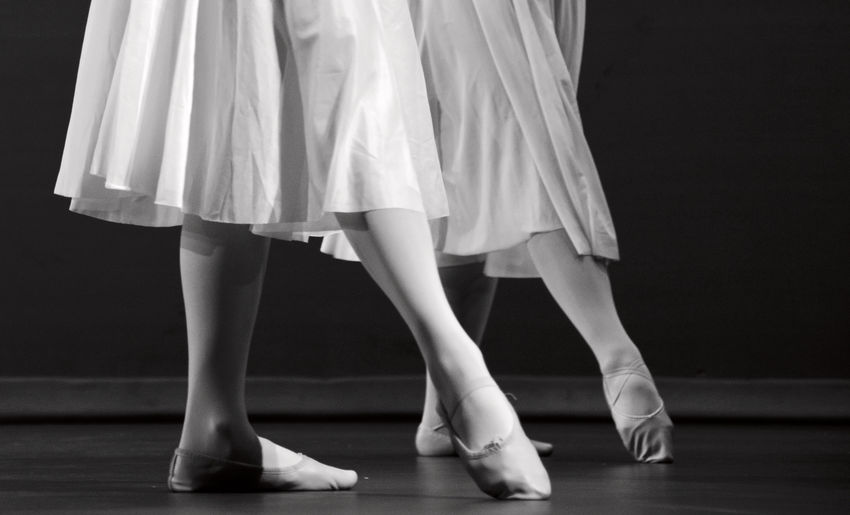 Feet of a duet of ballerinas on pointe in black and white Angle; Ballerina Ballet Class Dancer Dancing Feet Floor Girl Leaf Legs Performance Position Practice Reflection Rehearsal Shopping Slippers Streetphotography Studio Young
