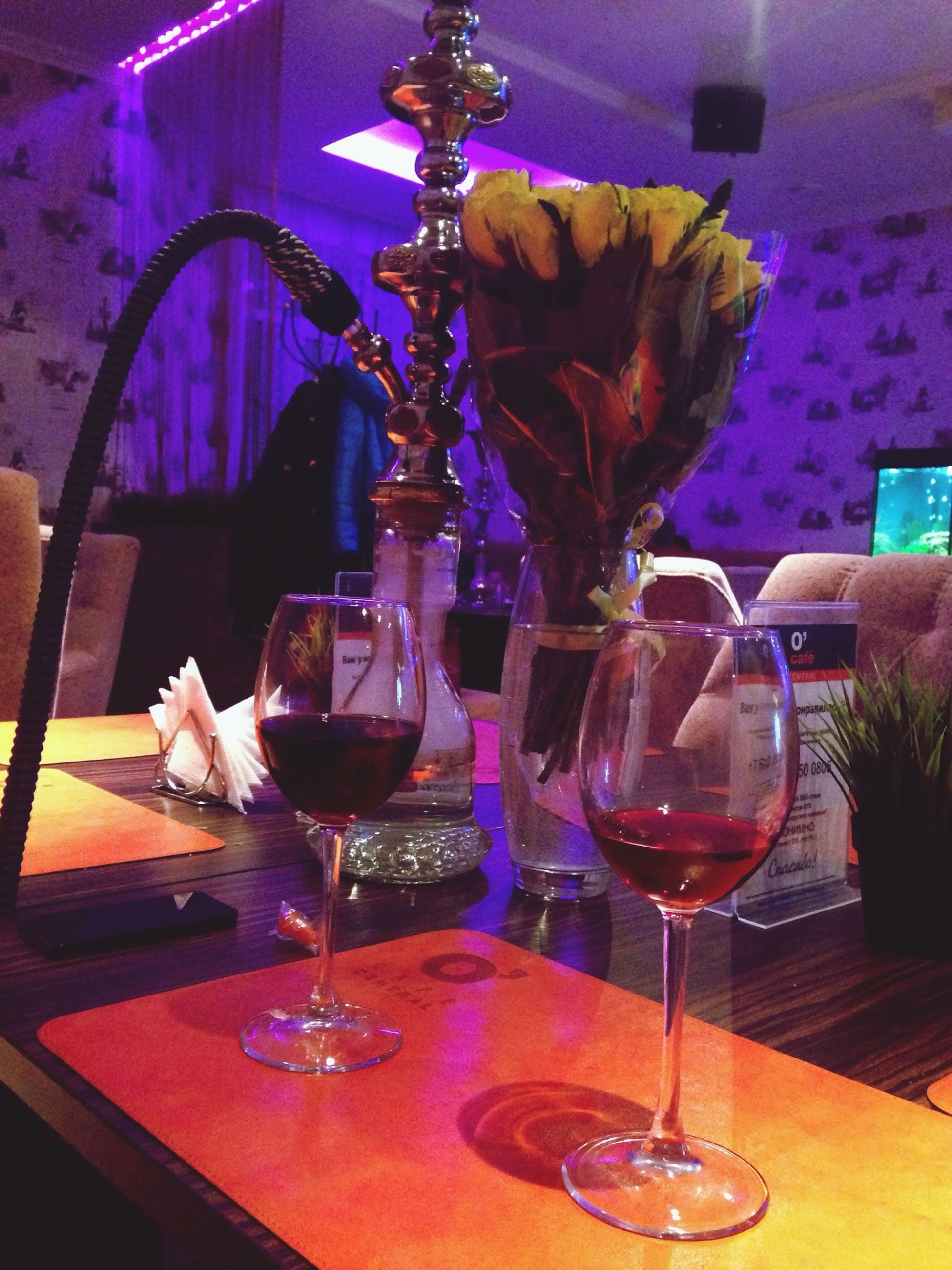 indoors, table, drinking glass, glass - material, drink, wineglass, food and drink, transparent, refreshment, still life, freshness, restaurant, vase, home interior, glass, flower, wine, alcohol, close-up, chair