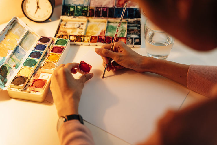 High angle view of woman hand on table