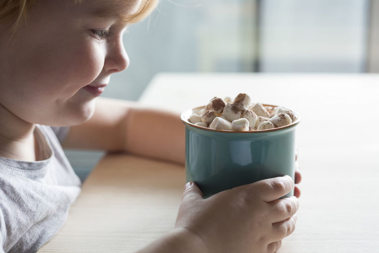 Close-up of girl holding hot chocolate