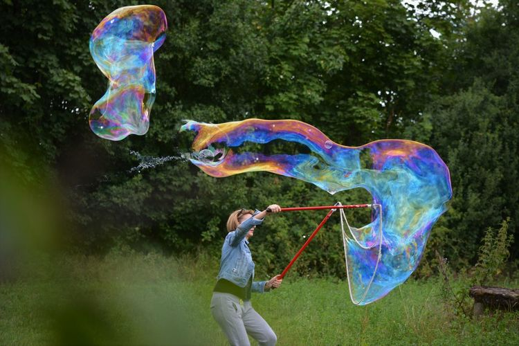 Colors Eyeem Happy ;)  Happiness Banksyart Blowing Bubble Bubble Wand Casual Clothing Environment Fragility Freedom Fun Holding Multi Colored Nature One Person Plant Soap Sud Transparent Tree Vulnerability  With My Eyes