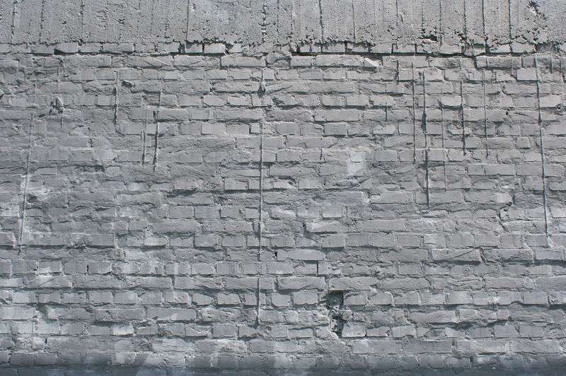 thin layer of plaster on a brick wall Wall Brick Bricks Plaster Layer Thin Old Gray Background Texture Pattern Surface Wallpaper Urban Structure Cracked Material Revetment Vintage Solid Decor Decoration Stonewall Dye Design Cement Clean Broken Brickwork  Obsolete Rock Row Building Stone Grunge Concrete Pieces Abstract Many Rough Revival Construction Façade Wide Hole Tiles Rustic Messy Frame Block