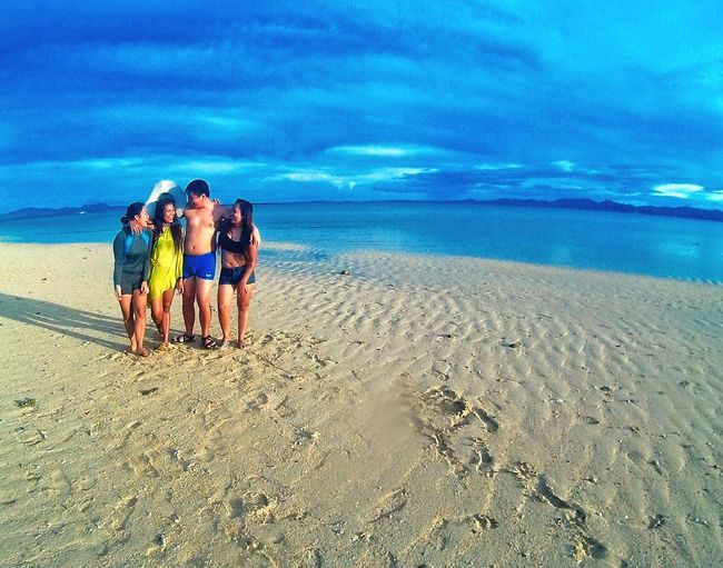 Overnight Success Friends Enjoying Life Togetherness Beach Sand Bonding Love Eyeem Philippines Person Cloud - Sky Rear View Romance Men Sky Tranquil Scene Leisure Activity Blue Vacations Water Tranquility Casual Clothing Uniqueness Miles Away Long Goodbye EyeEm Diversity
