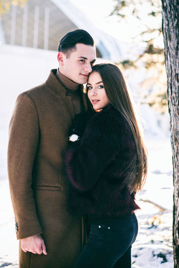 Adult Adults Only Affectionate Bonding Cold Temperature Couple - Relationship Day Embracing Happiness Love Men Outdoors People Real People Smiling Sunlight Togetherness Two People Warm Clothing Winter Women Young Adult Young Women