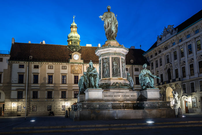 Kaiser Franz I statue in courtyard of Hofburg Palace in Vienna at night Austria City Cityscape European  Hofburg Travel Vienna Architecture Arts Culture And Entertainment Austrian Building Exterior Built Structure Capital Cities  Europe History Human Representation Illuminated Kaiser Low Angle View Night Outdoors Statue Travel Destinations Urban Wien