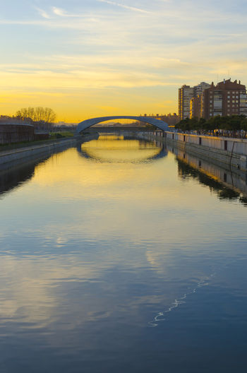 Manzanares River Arch Bridge Architecture Bridge Bridge - Man Made Structure Building Building Exterior Built Structure City Cityscape Cloud - Sky Connection Manzanares Nature No People Outdoors Reflection River Sky Sunrise Sunset Transportation Water Waterfront