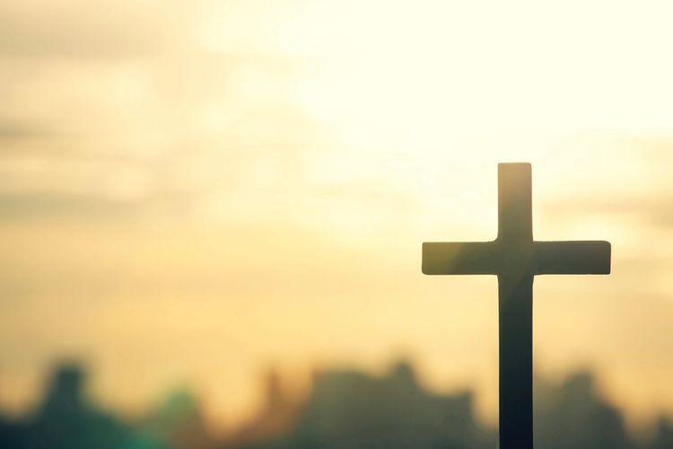 Cross against sky during sunset