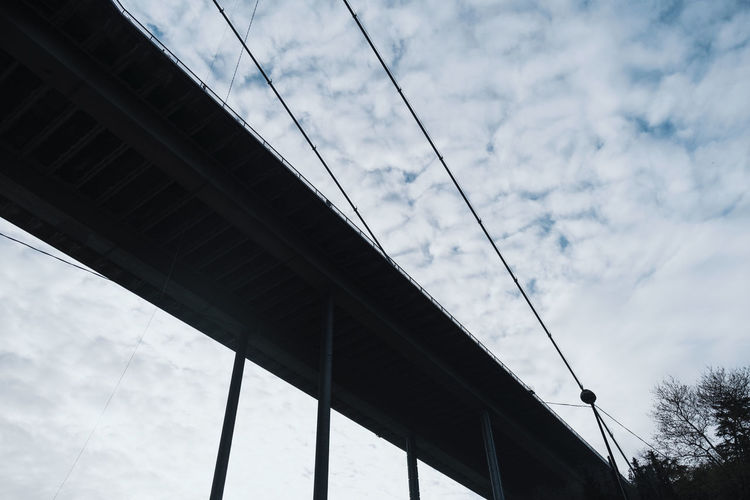 Cloud - Sky Bridge Built Structure Architecture Sky Connection Bridge - Man Made Structure Low Angle View Transportation No People Nature Day Outdoors Elevated Road Metal Cable City Strength Road Overpass Multiple Lane Highway
