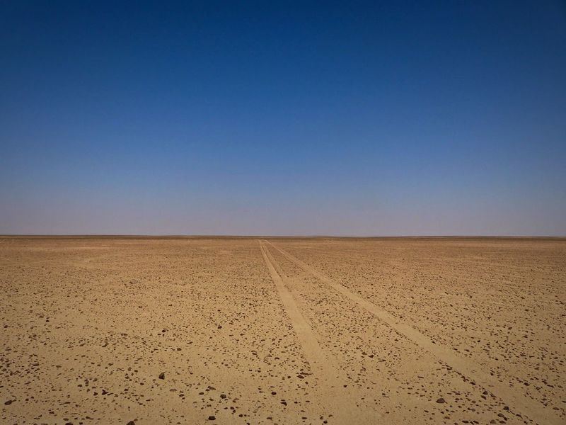 The Empty Quarter Deserts Around The World Empty Places Oman Arid Climate Blue Clear Sky Day Desert Desert Beauty Desert Landscape Empty Empty Road Landscape Nature Outdoors Rub Al Khali Sand Sky Way Forward