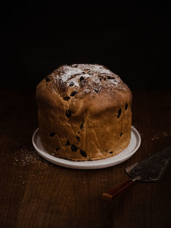 Panettone, a traditional Italian yeast cake with raisins, dried fruits and chocolate chips dusted with icing sugar, prepared for festivities such as Christmas or New Year Christmas Christmas Cake Homemade Homemade Food Italia Panettone Tradition Weihnachten Xmas Baking Cake Close-up Food And Drink Indoors  Italian Italian Food Italy Italy❤️ No People Panatone  Panatton Panettone Milanese Panettone Tradizione Sweet Traditional Food