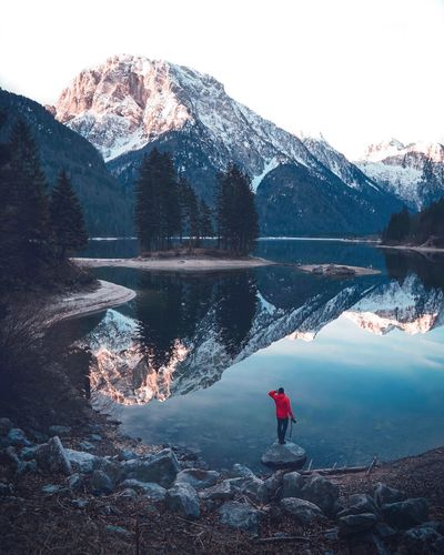 Lago del Predil 🇮🇹 Sunrise Reflection Italy Water Lake One Person Beauty In Nature Nature Scenics - Nature Real People Reflection Winter Standing Mountain Cold Temperature Tree Sky Tranquility Tranquil Scene Day Outdoors