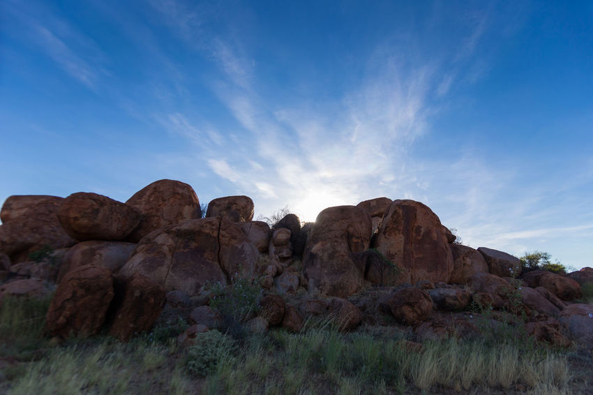 Sunset at the Devils Marbles, Australia. Incredible atmosphere between those unreal rock formations. Back Light Backlight Beauty In Nature Cloud - Sky Clouds And Sky Day Desert Devils Marbles Geology Karlu Karlu Landscape Nature No People Outdoors Rock - Object Rock Formation Scenics Sky Sky And Clouds Sunset The Natural World Tranquil Scene Tranquility Travel Destinations