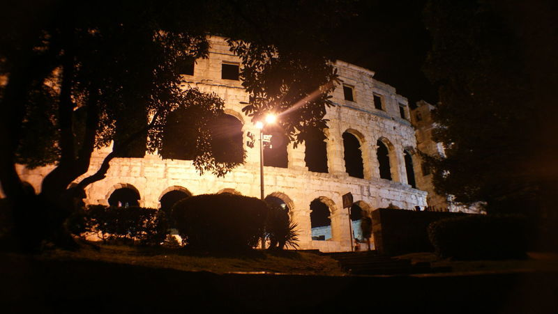 Croatia Architecture Building Building Exterior Built Structure City Collosseum History Illuminated Light Lighting Equipment Nature Night No People Old Outdoors Plant Pula Reflection Street The Past Tree Window