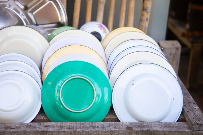 High angle view of plates in container at home