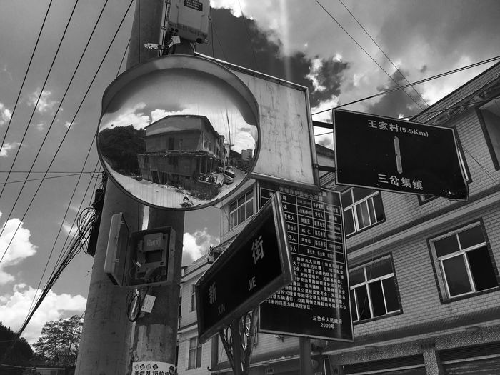 Breathing Space Building Exterior Built Structure Low Angle View Outdoors Sky Road Sign Day Architecture Black Blackandwhite Black And White Monochrome The Week On EyeEm