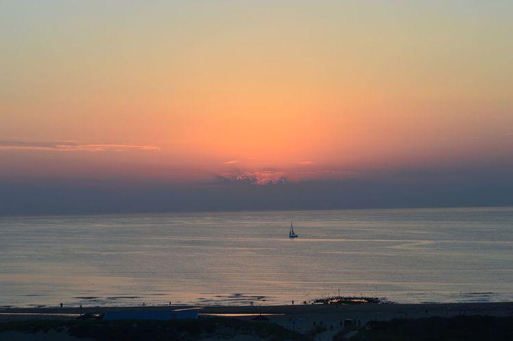 Sunset Sun Beach Sand Sea Sky Orange Sky Ocean Blue Water Boat Boat In The Sea Horizon The Hague Netherlands