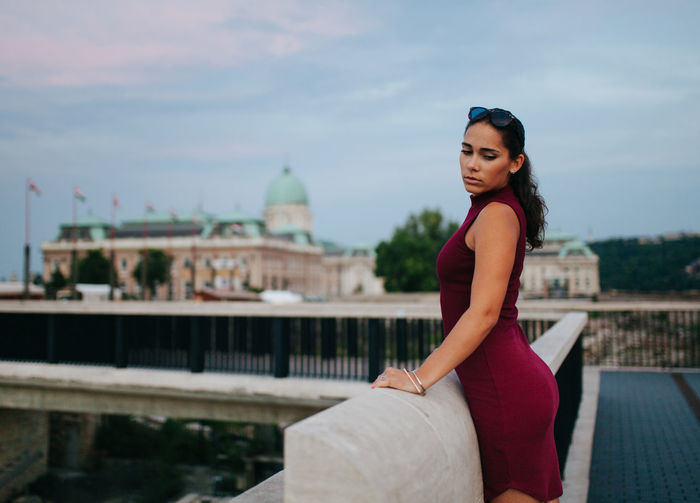 Summer vibes Brunette Budapest Castle Casual Clothing EyeEm Best Shots Focus On Foreground Hungary In Front Of Leisure Activity Lifestyles Long Hair Medium-length Hair Modeling Serious Sky Sunglasses Sunset TeamCanon Three Quarter Length Tourism Weekend Activities Young Adult Young Women People And Places