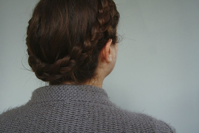 Rear View Of Woman Against Gray Background