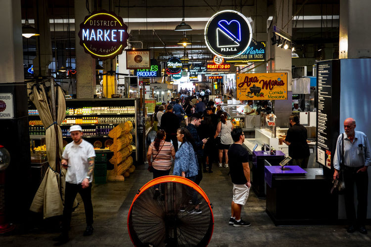 Grand Central Market, Los Angeles Central Grand Market Los Angeles, California Food Tourist Visiting Destination Travel Destinations City Real People Group Of People Men Architecture Transportation Illuminated Night City Life Building Exterior Built Structure Text Women Street People Lifestyles Adult Mode Of Transportation Sign Communication