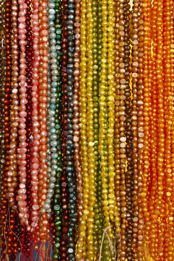 Assorted glass bead necklace collection at retail display Backgrounds Multi Colored Full Frame No People Close-up Large Group Of Objects Variation Yellow Choice In A Row Beads Beads Necklace Bead Necklace Necklace Retail  Retail Display Collection Glass - Material Accessories Glass Beads String Of Beads Chaplet Copy Space