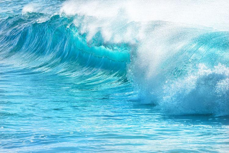 Sea waves splashing in swimming pool