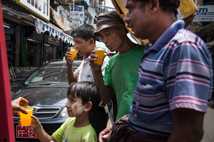 At the street juice stall in downtown Yangon, Myanmar ASIA Boy Burma Downtown Drinking Drinking Glass Drinking Juice Men Men Only Myanmar Orange Orange Color Orange Juice  Rangoon South East Asia Street Street Photography Street Scene Streetphoto Streetphoto_color Streetphotography Thirst Yangon