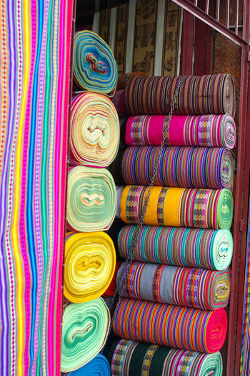 Colorful tissues in Cusco ALPAGA Andes Mountains Cusco Inca Industry Local Peru Tissue Tradition Travel UNESCO World Heritage Site Abundance Arrangement Choice Civilization Close-up Collection Colorful Fairtrade For Sale In A Row Indoors  Large Group Of Objects Llama Market Multi Colored No People Precolombian Retail  Retail Display Roll Rolled Up Sale Side By Side South America Still Life Store Textile Tourism Variation Whool