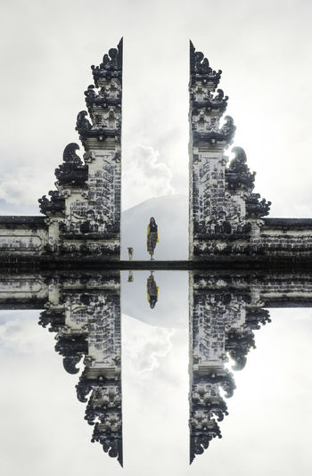 ASIA INDONESIA Lempuyangtemple Mirror Woman Woman With Dog Architecture Belief Building Building Exterior Built Structure Cloud - Sky History Nature Outdoors Place Of Worship Reflection Religion Sky Spirituality Temple The Past Tourism Travel Travel Destinations Vulcano Water Waterfront