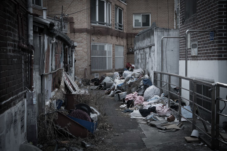 Garbage by building in city