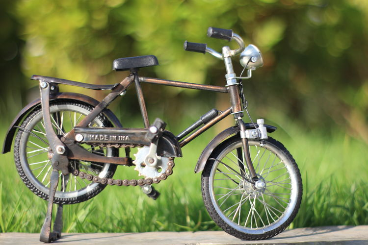Aceh Transportation Bicycle Mode Of Transportation Land Vehicle Day Focus On Foreground No People Stationary Wheel Metal Outdoors Nature Field Parking Close-up Travel Land Green Color Plant Tire