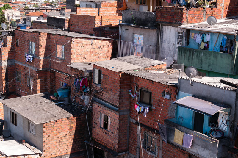 Shacks in the slum in a poor neighborhood of Sao Paulo Community Construction Architecture Building Exterior City Favela Hill House Illegal Outdoors Pool Poverty Residence Residential Building Shack Slum