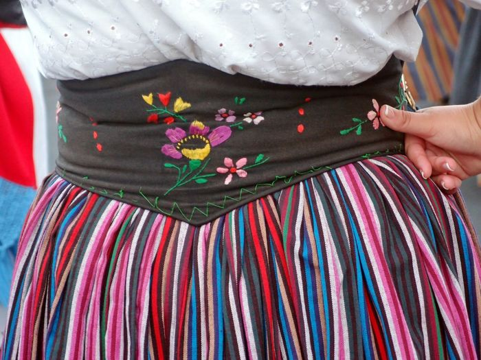 Midsection of woman standing in traditional clothing