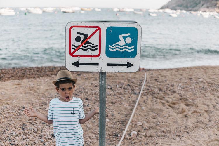 Full length of a boy standing on beach