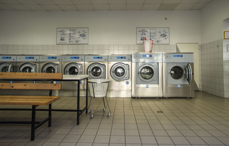 Row of washing machines in laundrette