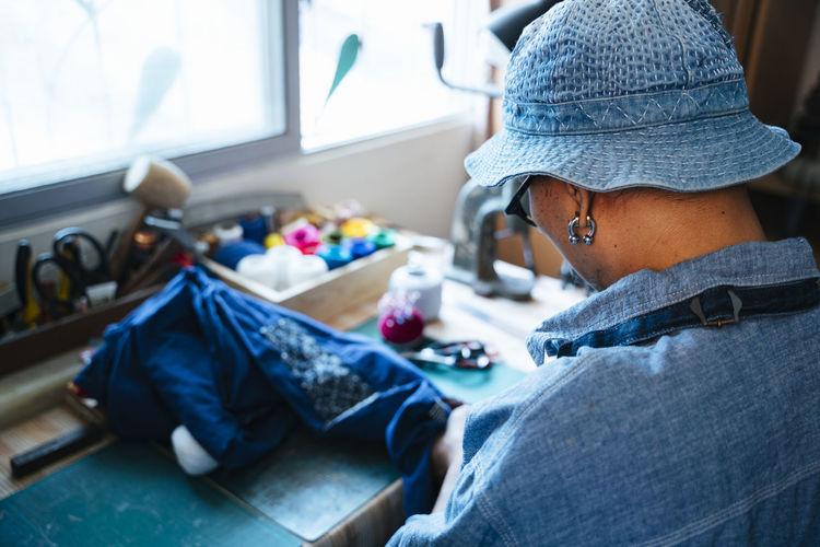 Rear view of man working in workshop