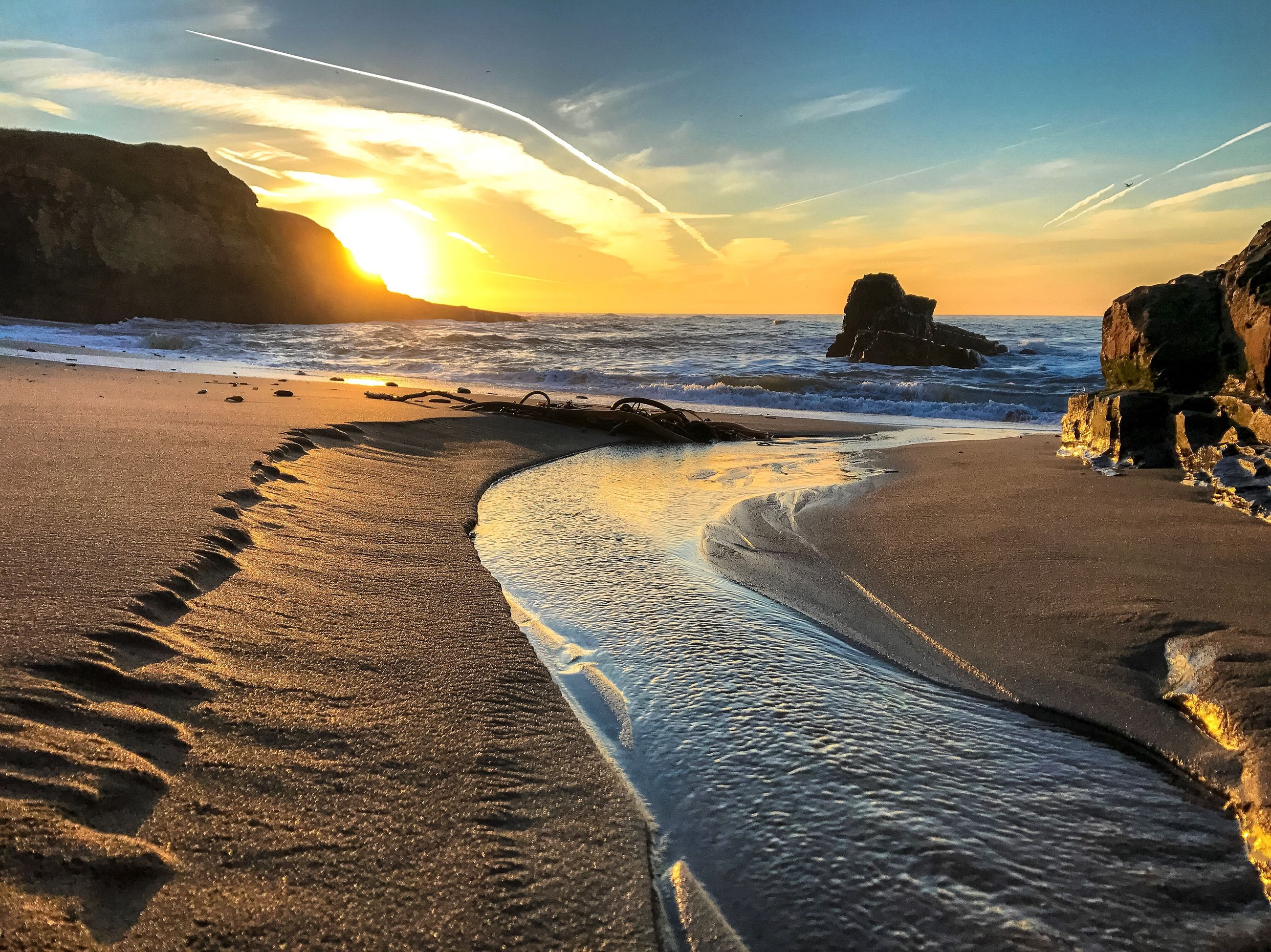 sea, beach, sand, nature, reflection, scenics, sky, horizon over water, sunlight, beauty in nature, water, sunset, outdoors, vacations, no people, wave, day