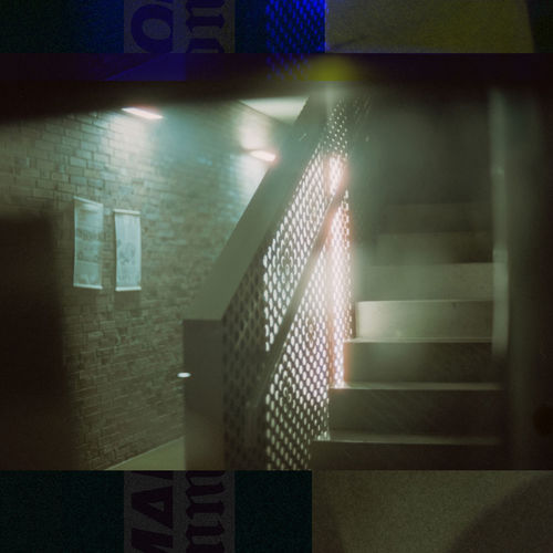 Digital composite image of illuminated staircase in building