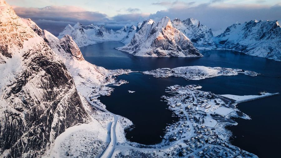 View over Reine, Norway. Norway Lofoten Water Sea Nature Beauty In Nature Cold Temperature Scenics - Nature Winter Sky Mountain Day Snow Outdoors Tranquil Scene Tranquility No People Environment Motion Ice Snowcapped Mountain