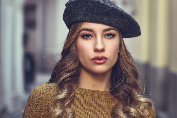 Beautiful Russian woman wearing beret looking at camera outdoors. The Portraitist - 2018 EyeEm Awards Adult Beautiful People Beautiful Woman Beauty Close-up Clothing Contemplation Fashion Front View Hair Hairstyle Hat Headshot Long Hair Looking At Camera One Person Portrait Warm Clothing Women Young Adult Young Women
