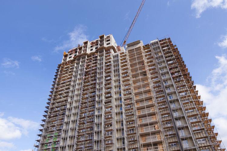 Construction crane building a new high-rise skyscraper or apartment building