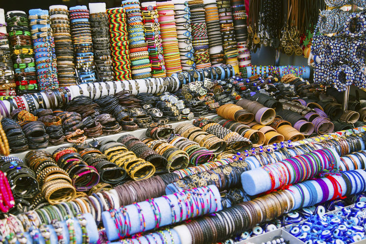 Abundance Accessories Arrangement Choice Collection Display For Sale Hand Handmade Large Group Of Objects Man Market Market Stall Multi Colored Order Retail  Shop Store Variation Woman