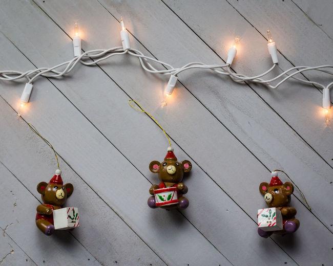 Illuminated christmas lights on street light
