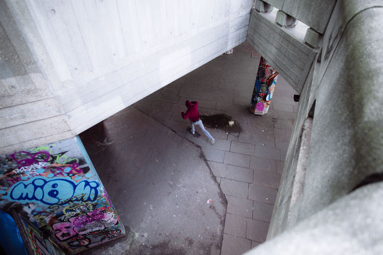 High Angle View Of Person Running On Street Under Footbridge