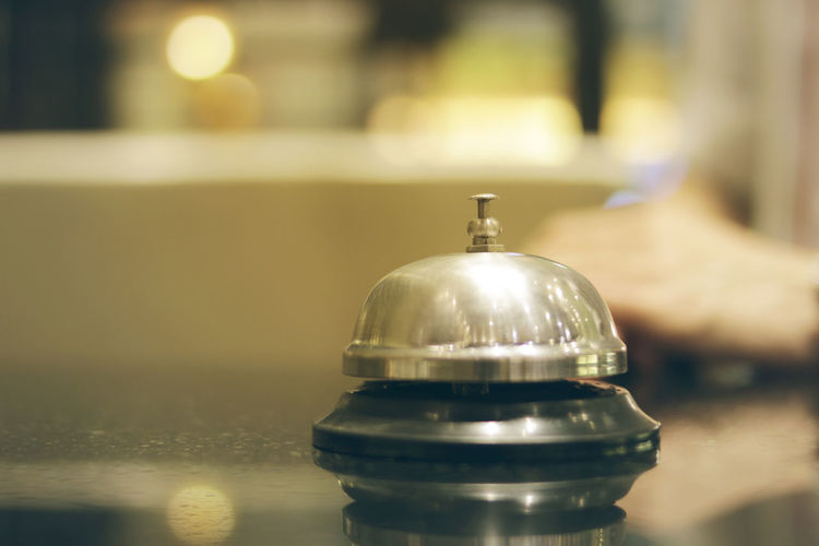 Close-up of service bell on table