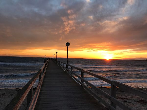 Sea Sunset Water Nature Horizon Over Water Beauty In Nature Scenics Tranquility No People Railing Sky Outdoors Tranquil Scene Pier The Way Forward Beach Cloud - Sky Fishing Pole Day Waterfront Traveling Tranquility Seascape